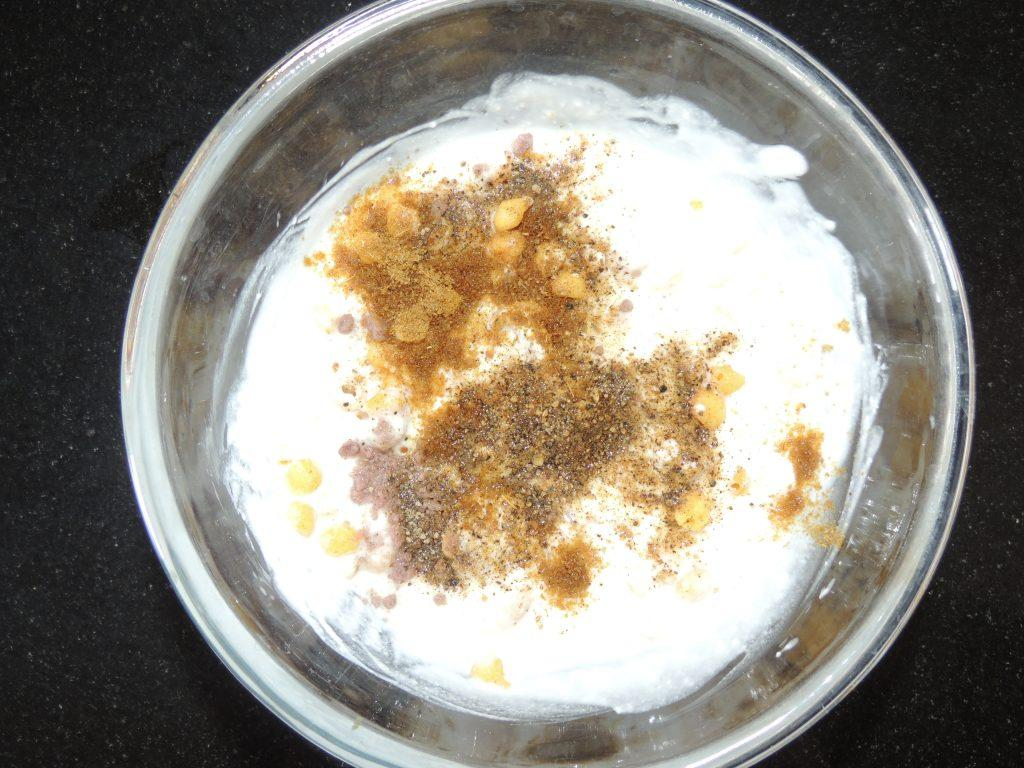 Add black pepper, black salt, white salt, cumin powder to the curd.