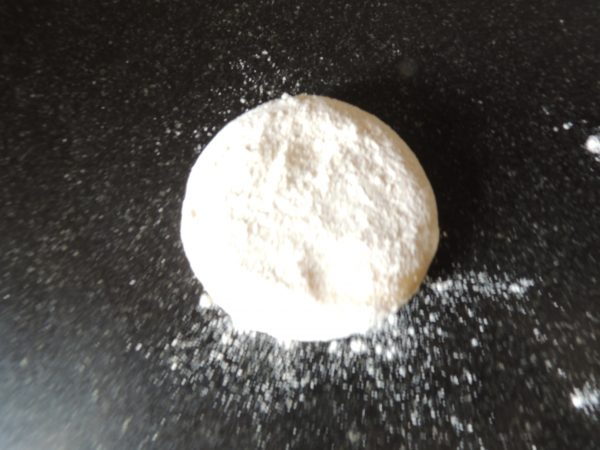 Coat one of ball with flour.