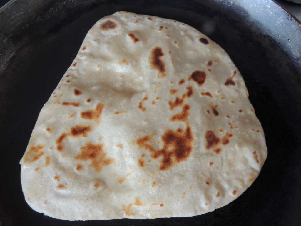 Apply 1/2 tbsp of oil all over the surface of paratha, if oil required more then take little more amount of oil.