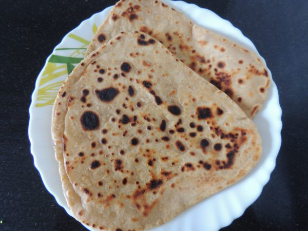 Now layered, crispy paratha is ready to eat.