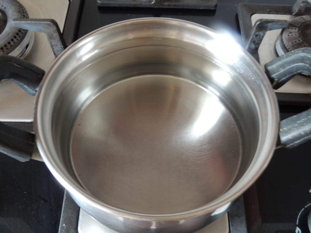 Take one stainless steel bowl and fill water in the bowl. And place bowl on the gas.