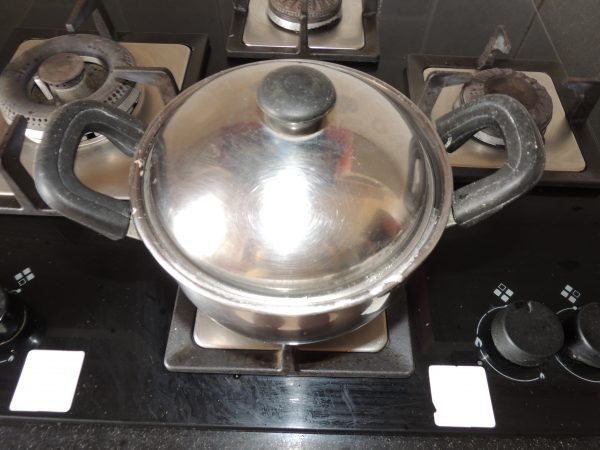 As soon as the water starts boiling, the water will come out of the lid