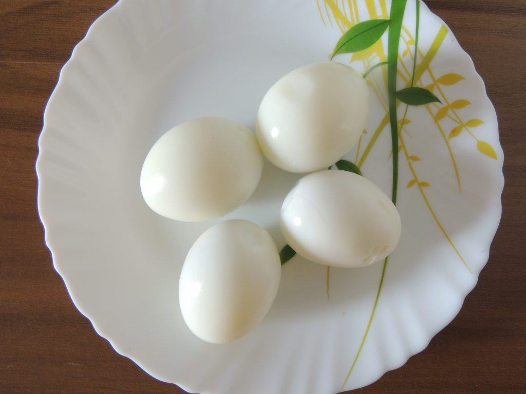 Once egg becomes cold. Press the eggs either with a spoon or on the ground. So that eggs are easier to peel. Peel eggs.