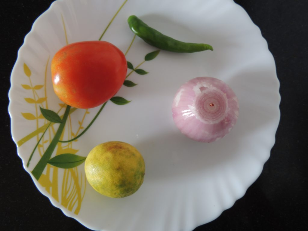 Take potato, green chilly, onion and lemon.