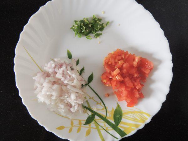 Chop tomato, potato, green chilly.