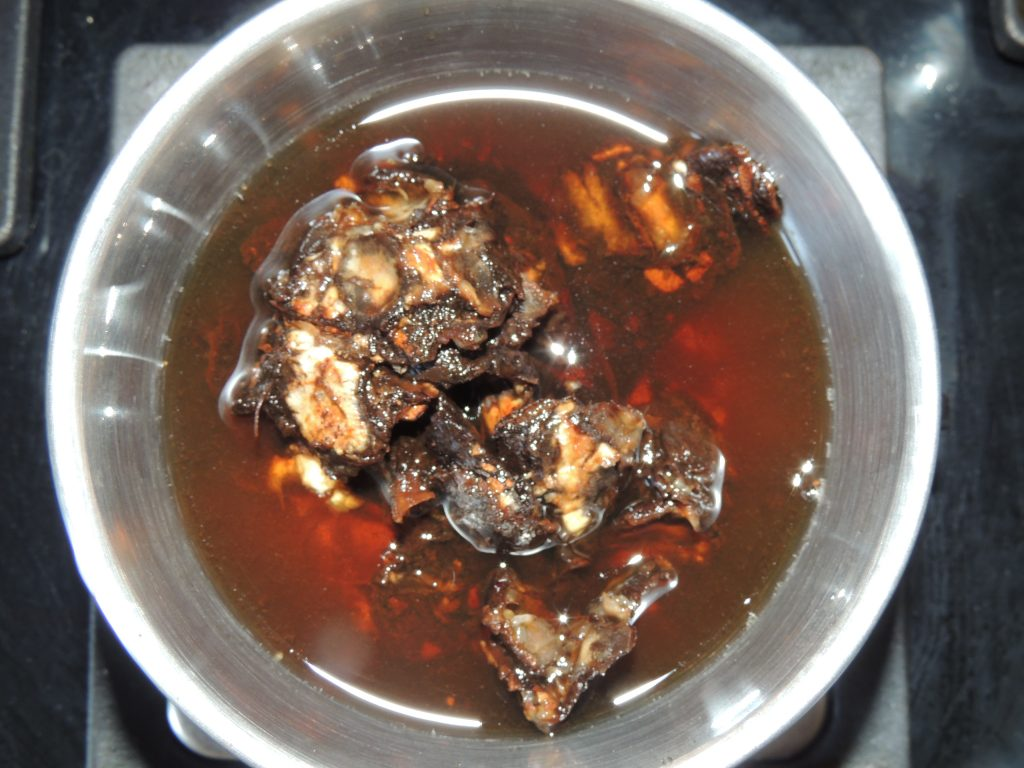 After that put tamarind into mixer jar with little water.