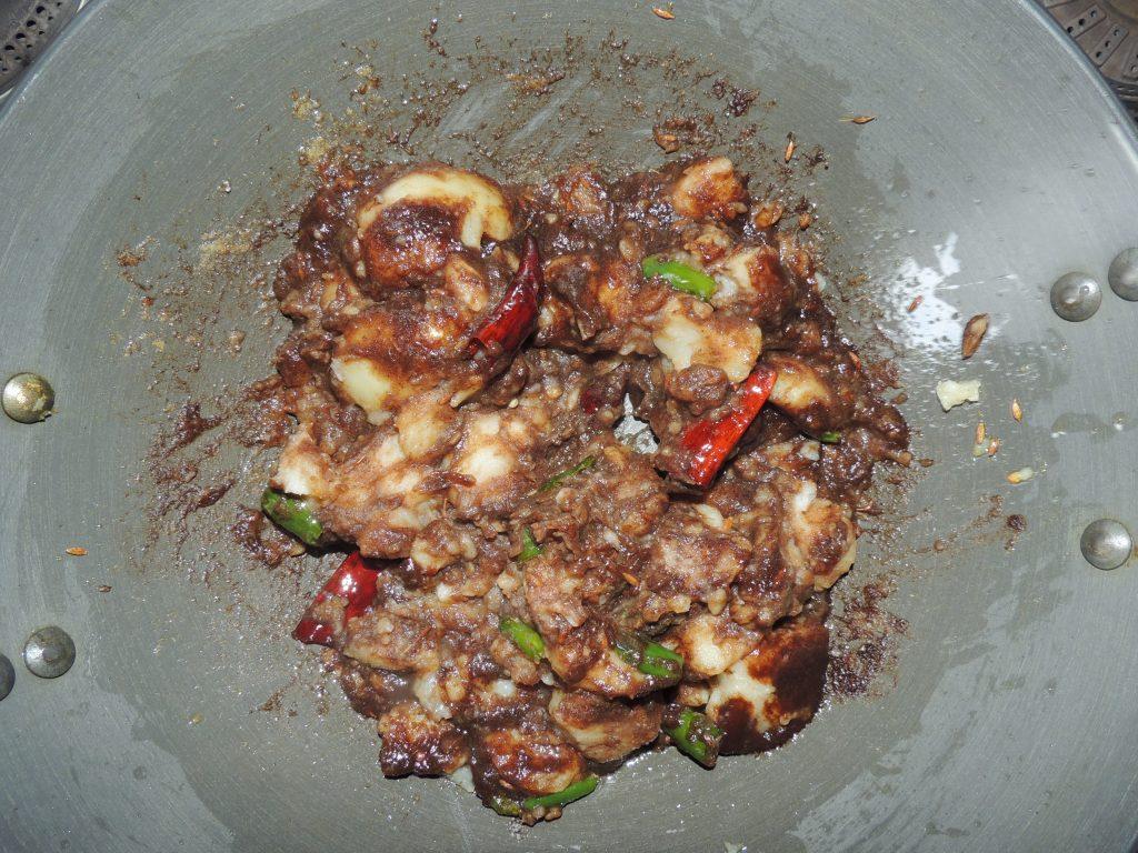 Mix tamarind with spatula.