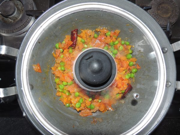 Stir the mixture and cover the pan with a lid.