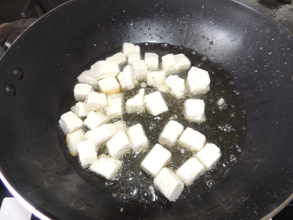 Chop cheese in cubical shape. Put the paneer in the pan / kadai to fry