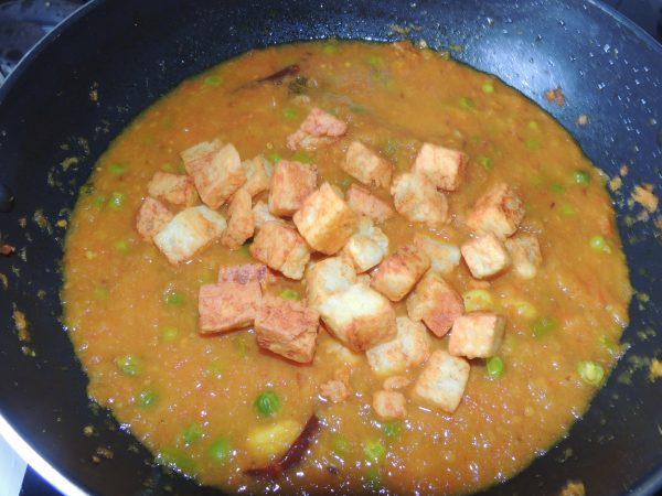 After that add fried cubes of cheese in the pan / kadai.