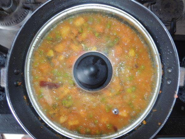 Close the kadai / pan with lid.