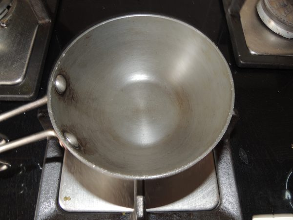 Now take again the same tadka pan and place on the gas.