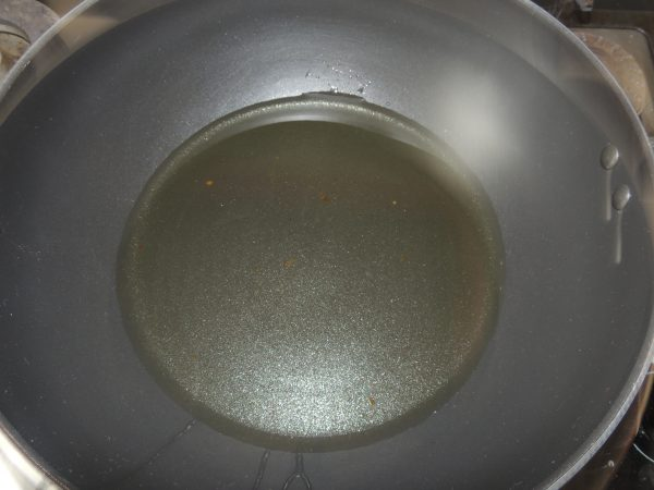 Pour oil into the pan.