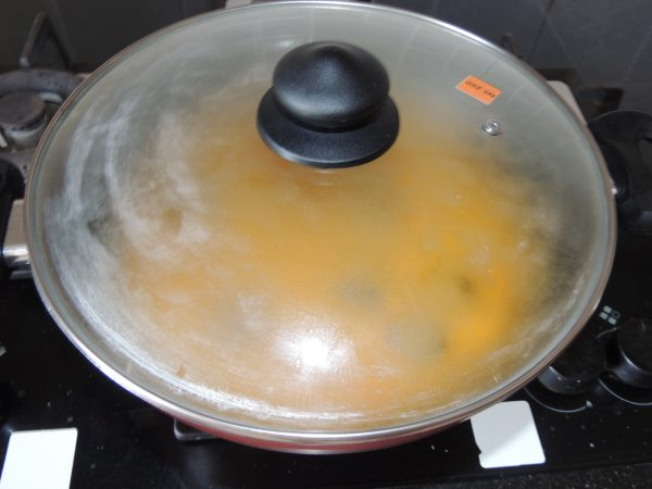 Cover the pan with lid.