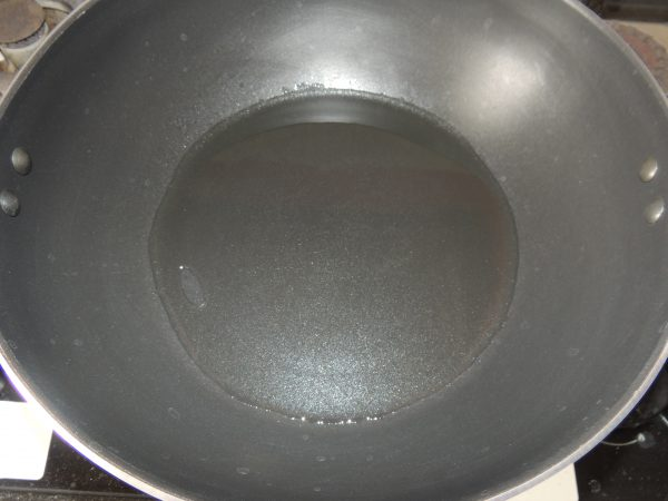 First take one fry pan or kadai, and place kadai on the gas.