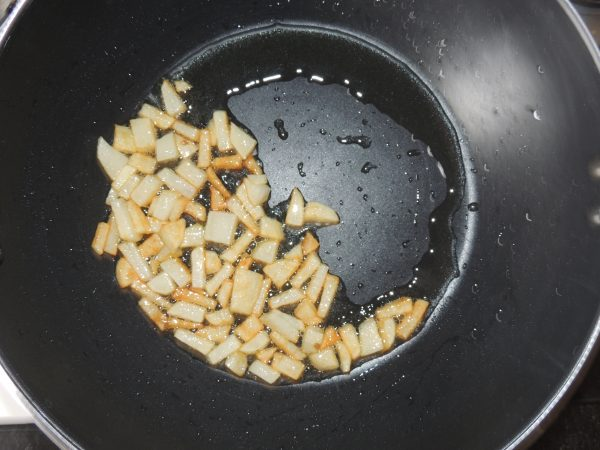 Fry the potatoes till they turn brown.