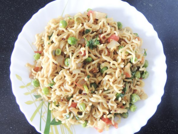 Now maggie is ready, sprinkle coriander leaves on maggie. Serve hot.