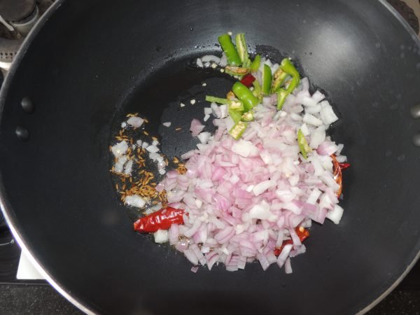 After 10 seconds add chopped green chilli and chopped onion.