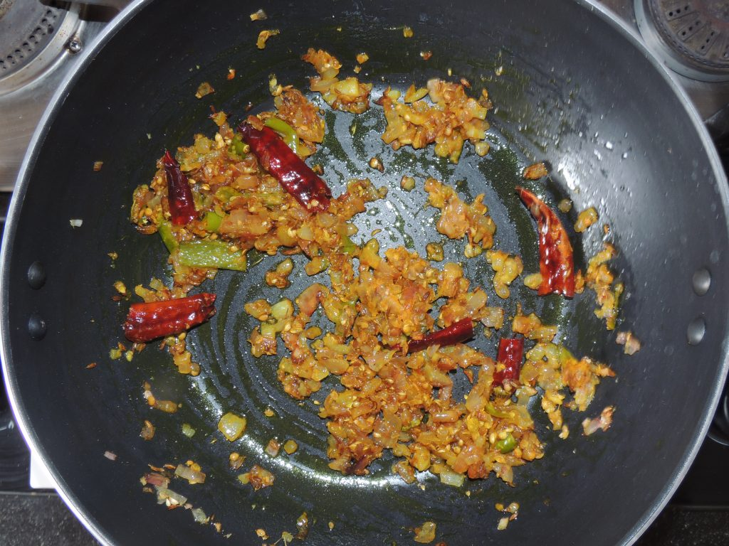 After that add turmeric into kadai / fry pan.
