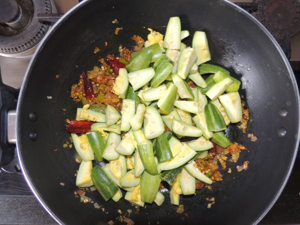 Then add chopped pointed gourd / parwal to the spices.