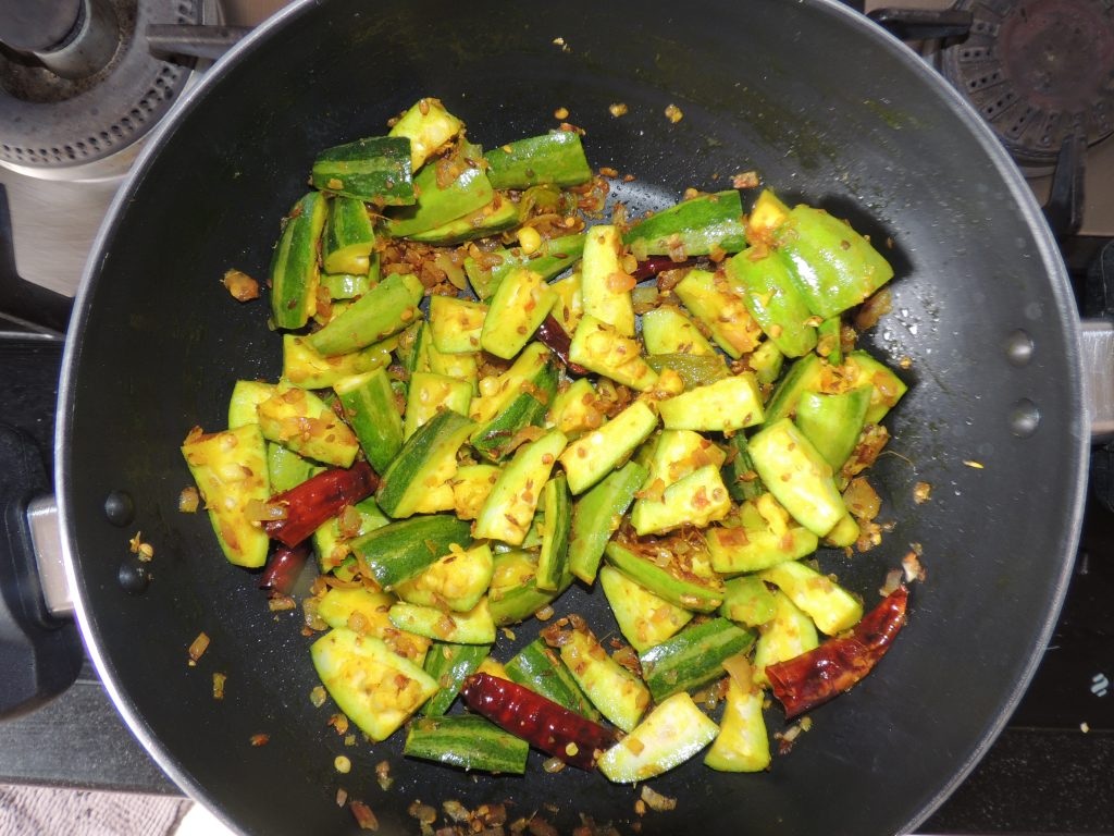 Mix chopped pointed gourd / parwal with spices.