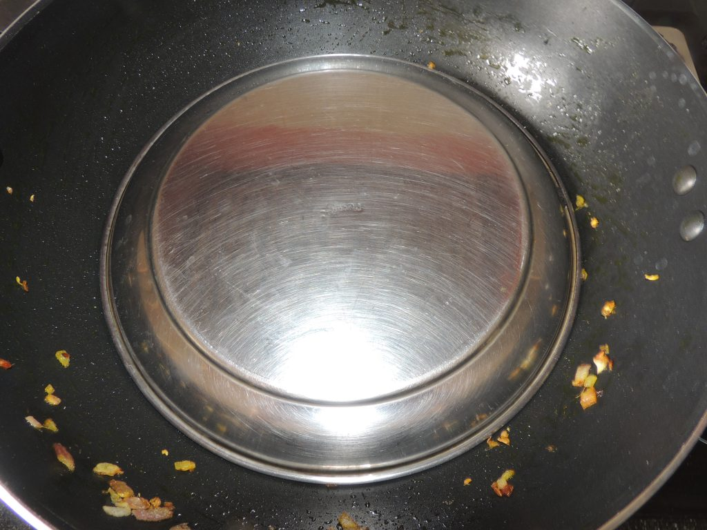 Cover the lid on the kadai / fry pan.