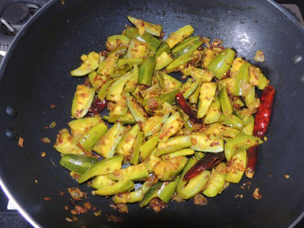 Leave the lid of the kadai / fry pan closed for five minutes. Keep stirring the vegetables periodically.