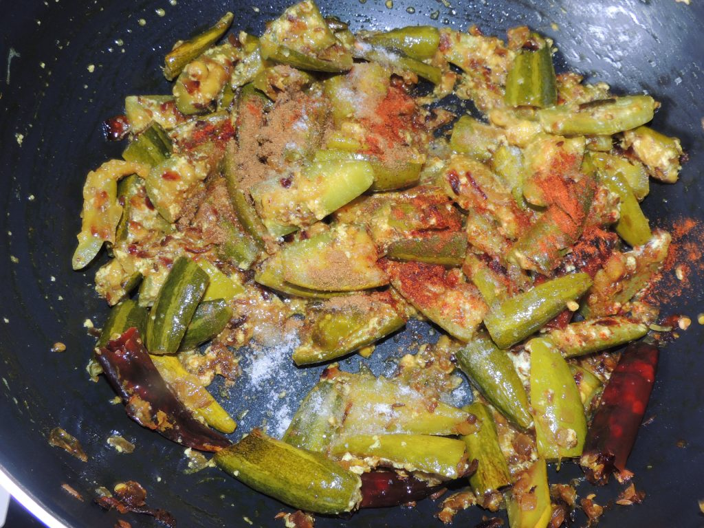 Add red chilli powder and garam spice / masala to the vegetable.