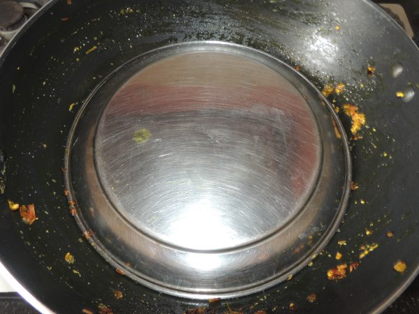Mix spices to the vegetable and close the lid of kadai / fry pan.