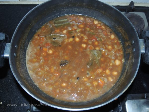 Serve hot chickpeas with puri or rice.