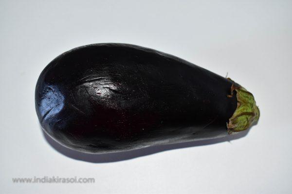 Take an eggplant to make brinjal bharta.