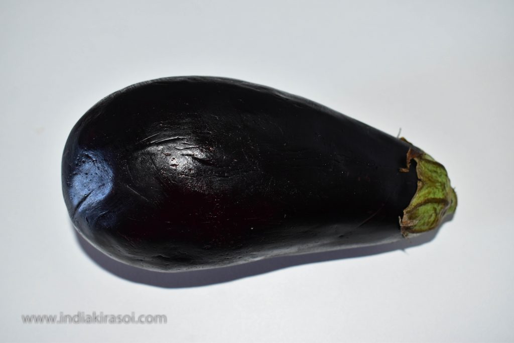 Take an eggplant to make brinjal bharta.