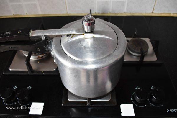 To make stuffed capsicum, first boil 3-4 potatoes in a pressure cooker.