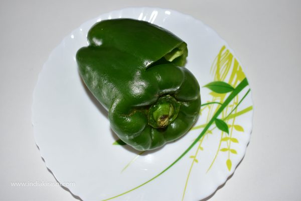 Cut the top of capsicum into round shape, The upper part should not cut completely, do not cut it full, so that when the mixture is filled in the capsicum, then close the cap and the mixture come will not come out.