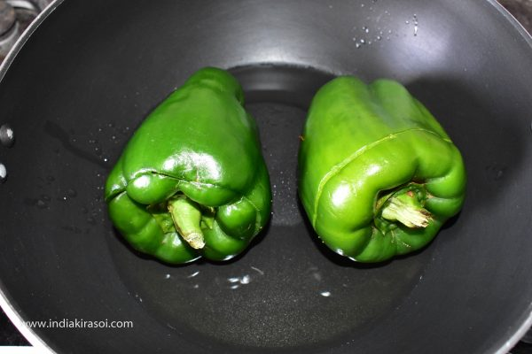 When the oil is hot, Then place capsicum in the kadai / pan.