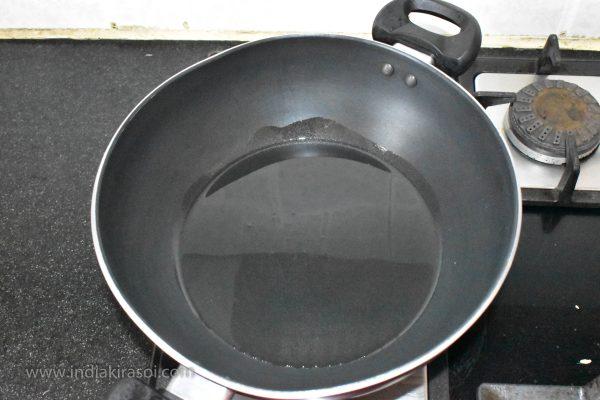 Put 2 spoons of oil in the kadai / pan.