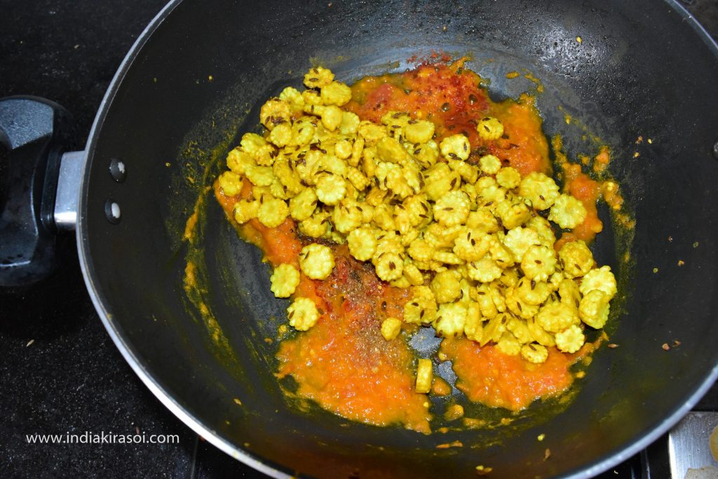 Now put the fried baby corn in the kadai / pan.
