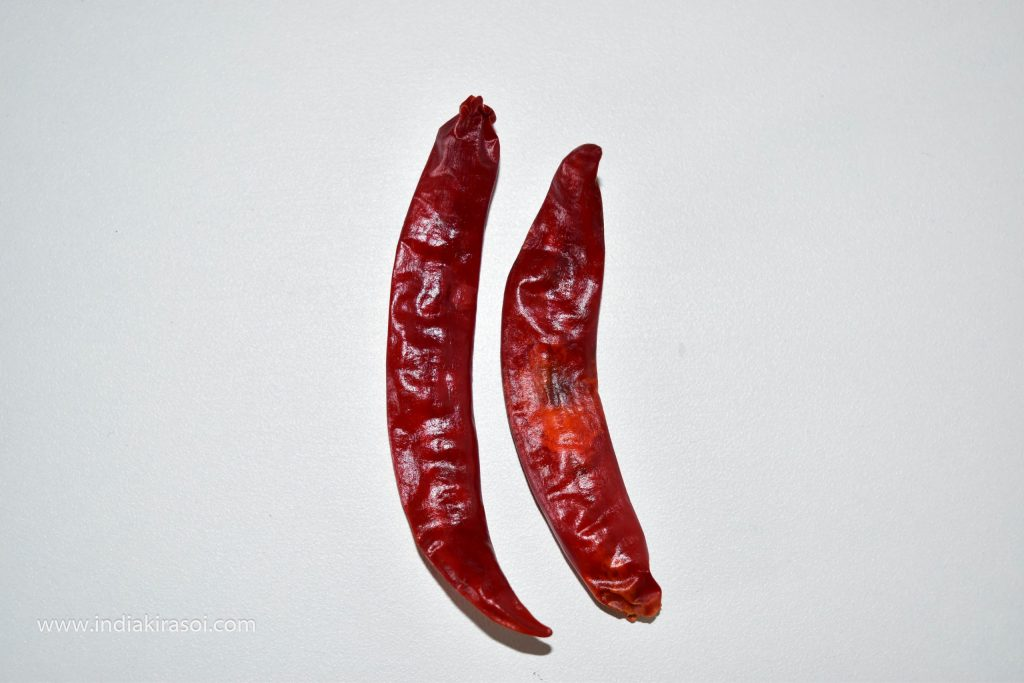 Take 2 red chili peppers.