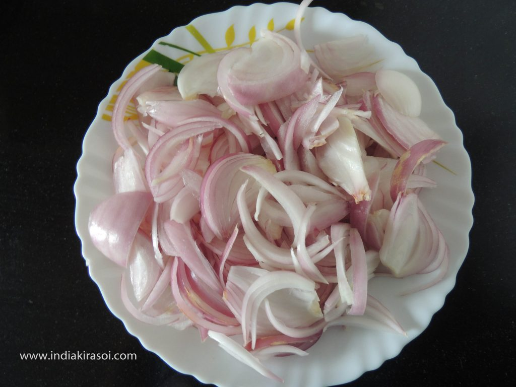 Take 2 medium sized onions and peel them and cut them into long pieces.
