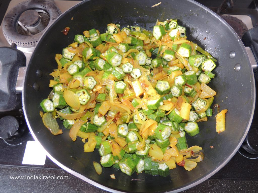 Now if the potatoes are cooked, then add chopped okra in it.