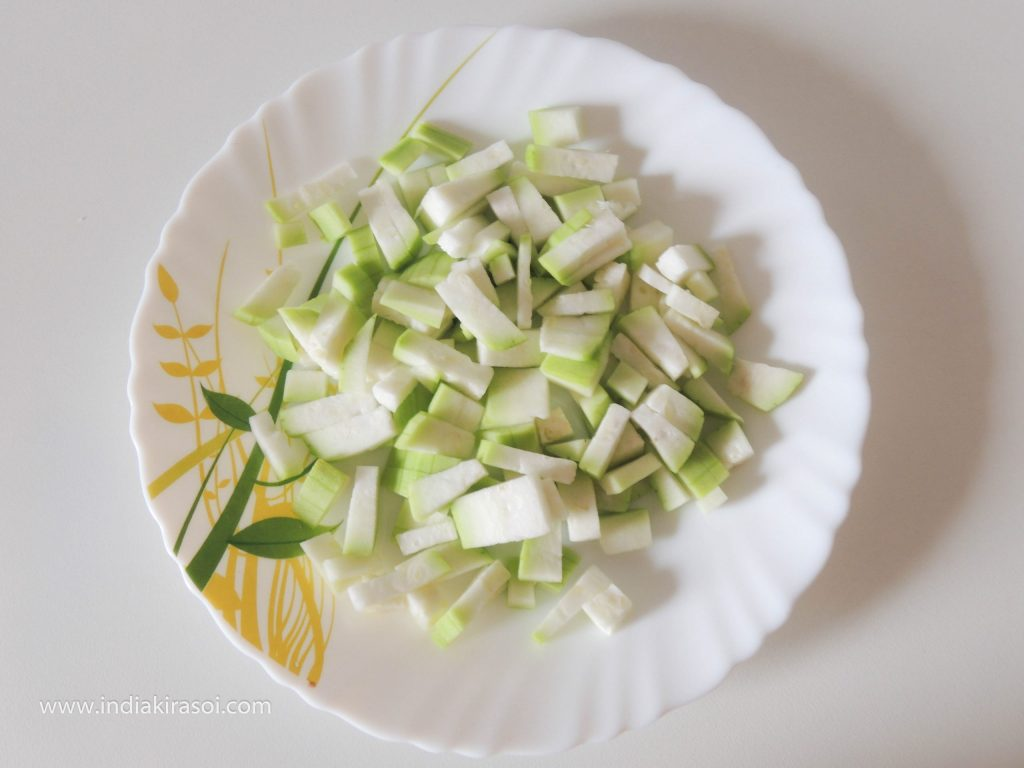 Finely chop Bottle gourd into pieces.