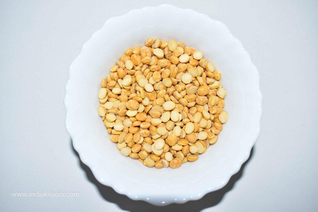Take half cup of Bengal gram lentil to make chana dal.