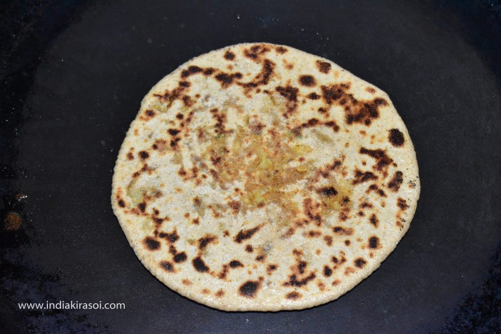 Bake both sides of the paratha properly, making sure that the paratha does not burn.