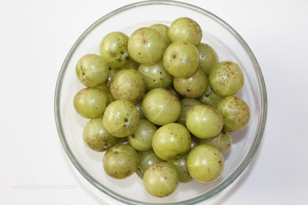 To make amla murabba/gooseberry murabba, take 1 kg of amla/gooseberry.