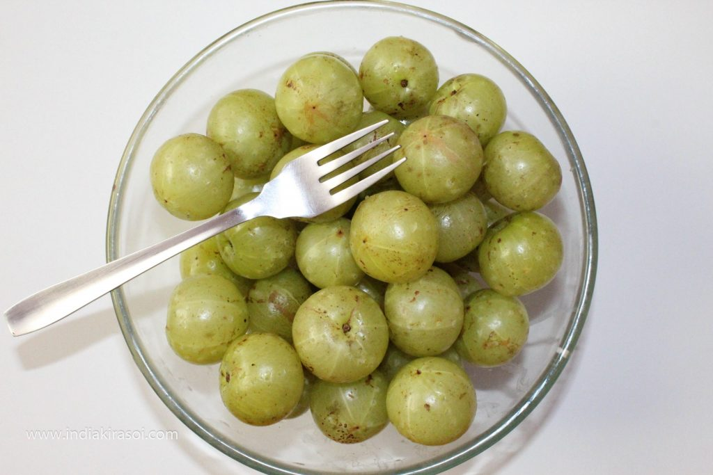 Prick amla/gooseberry with a fork.