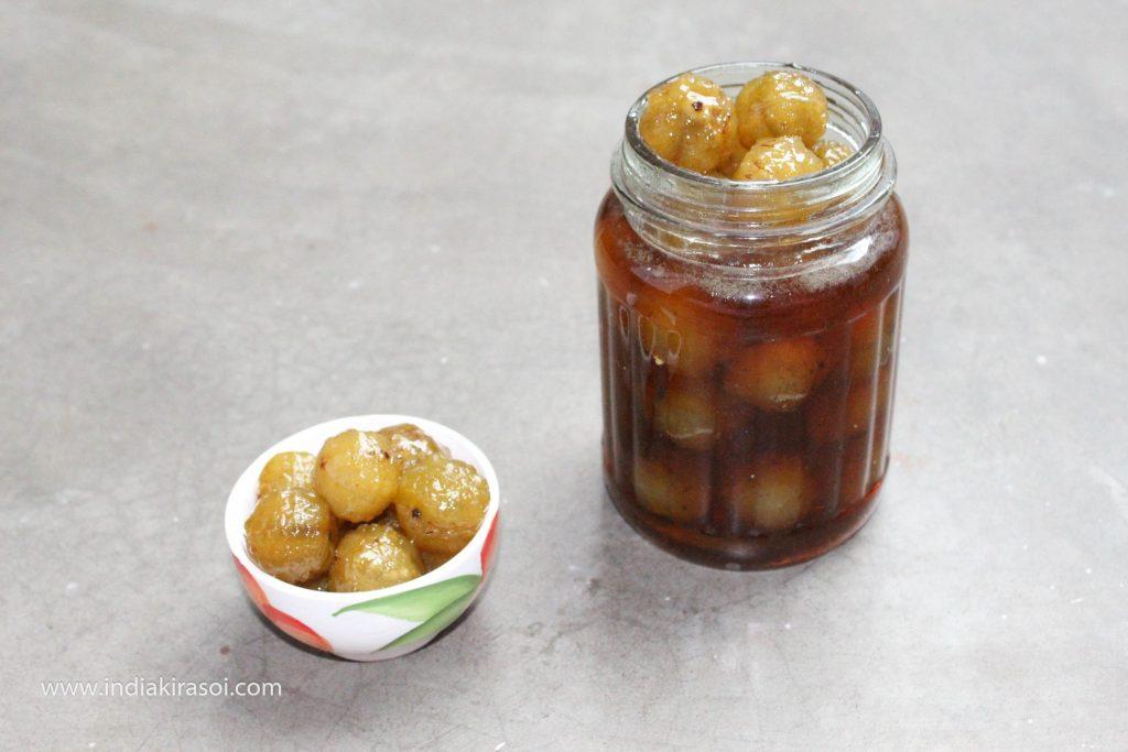 Put the Amla/Gooseberry murabba in a sterilized glass jar.