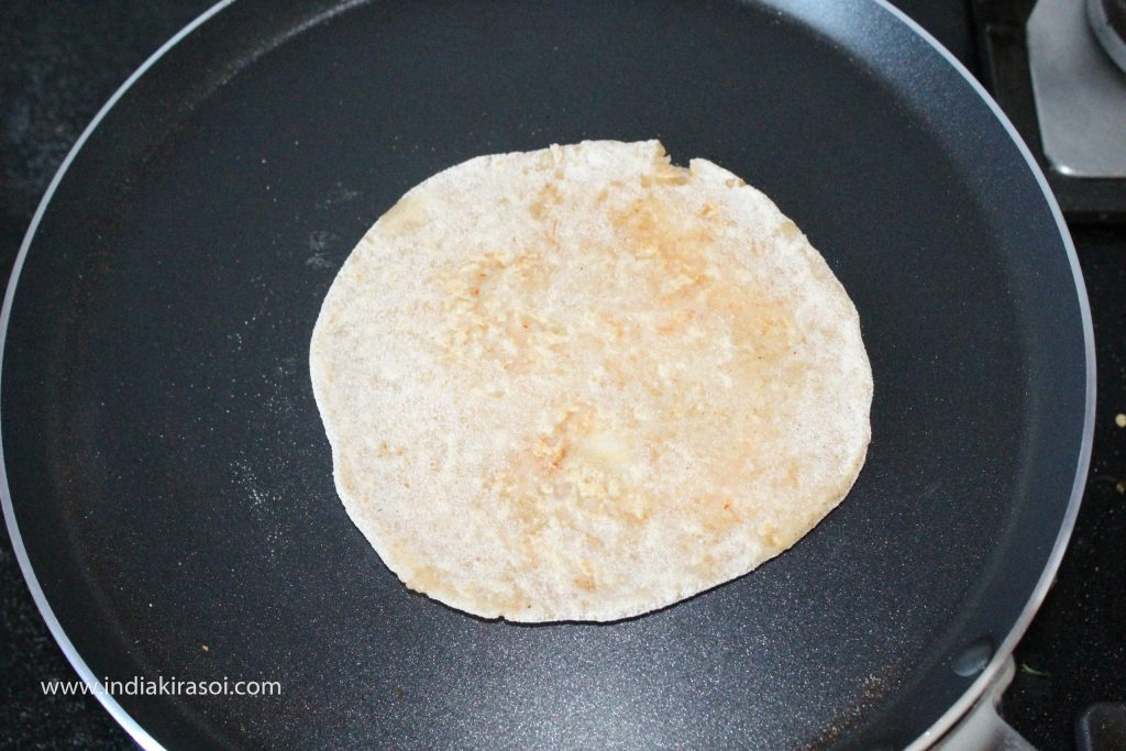Turn the paratha after about 30 seconds.