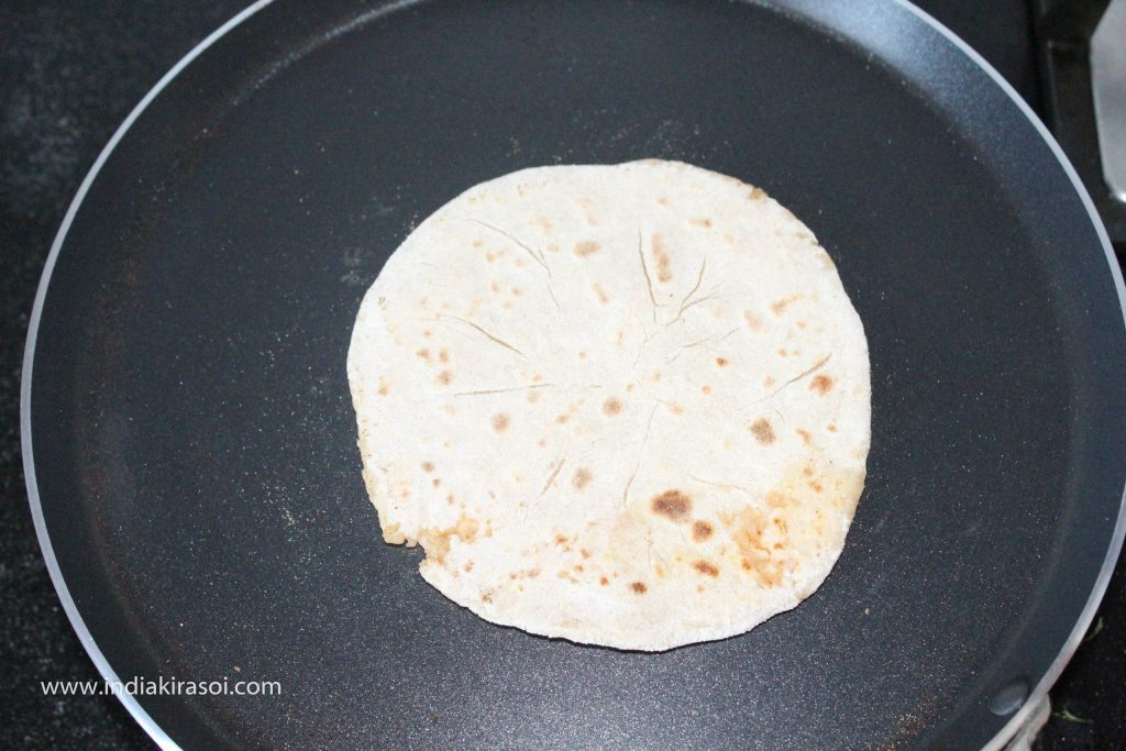 Now change the side of the paratha.