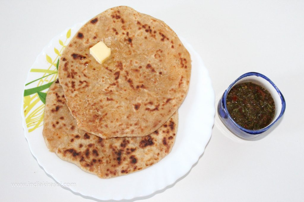 Serve radish paratha with chutney.