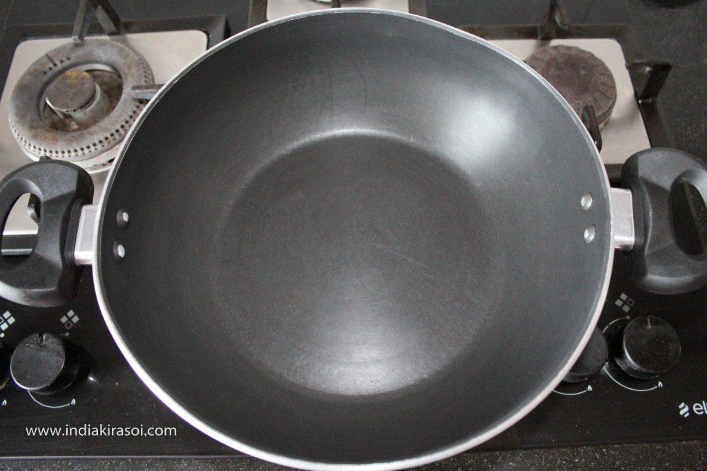 Put a kadhai/ fry pan/ cauldron on the gas.